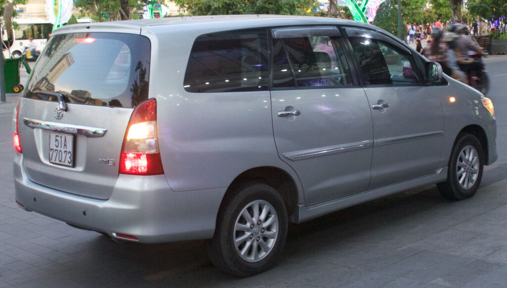 toyota innova crysta hire in delhi-Brown